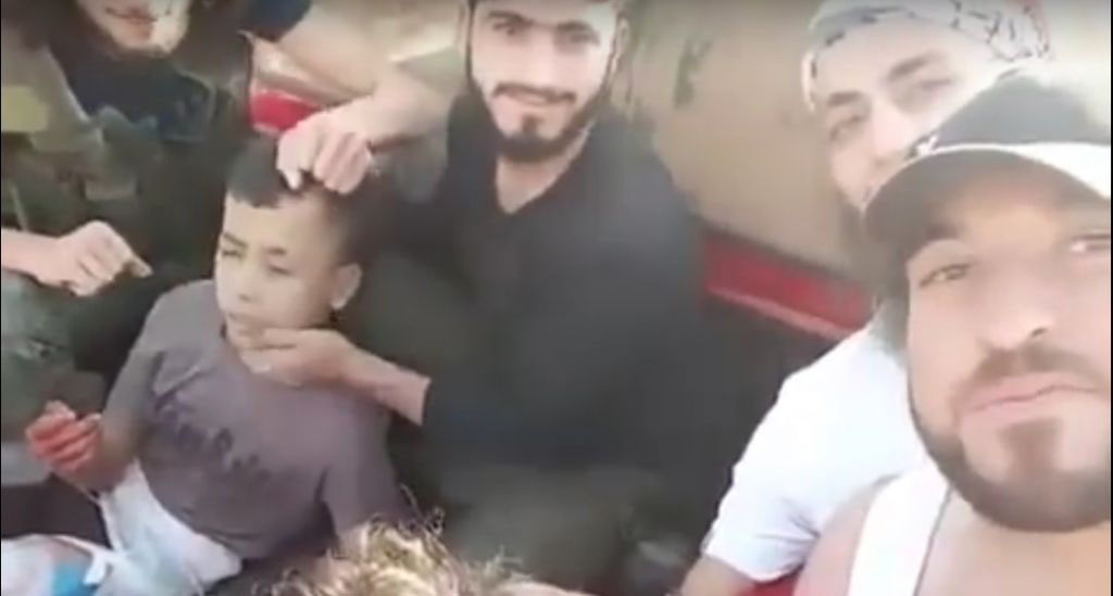 A video circulated on social media depicts rebel fighters beheading a boy after capturing him north of Syria's second city Aleppo. (screen capture: YouTube)