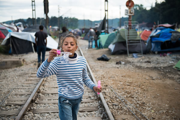 Wall Exhibition: Glimpses Over The Edge: Photographs Of Refugees by Alexander Treves