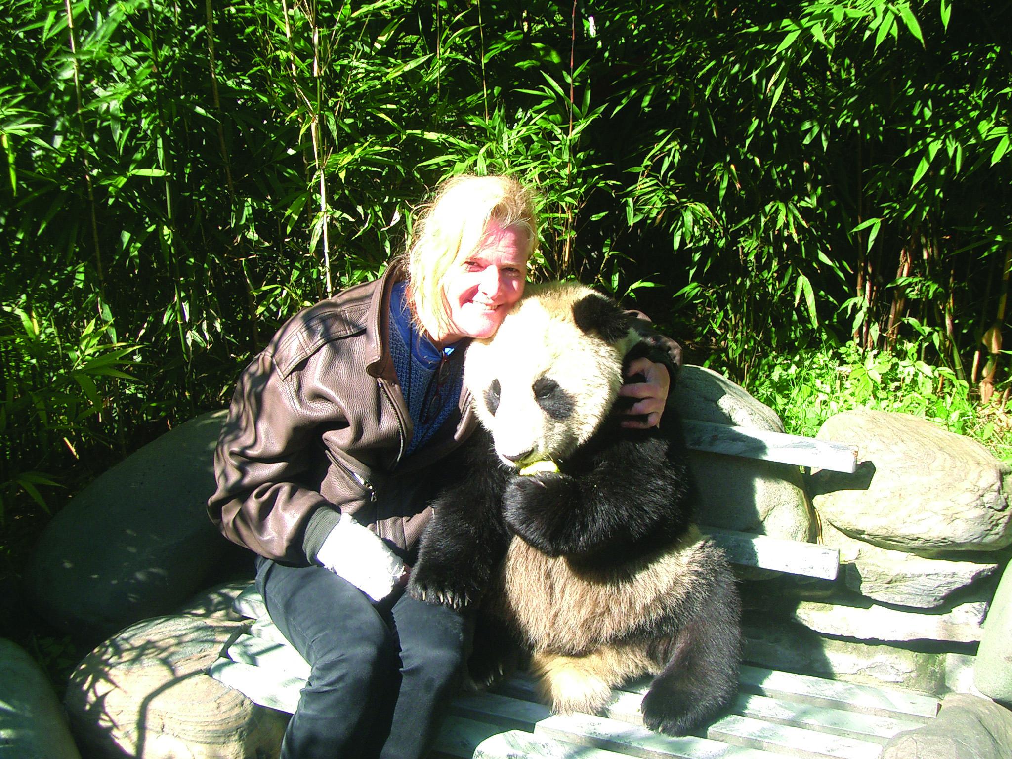 Karin Malmstrom with a Panda at Wolong