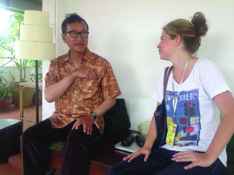 Kate Bartlett interviews opposition leader Sam Rainsy. Photo: Robert Carmichael