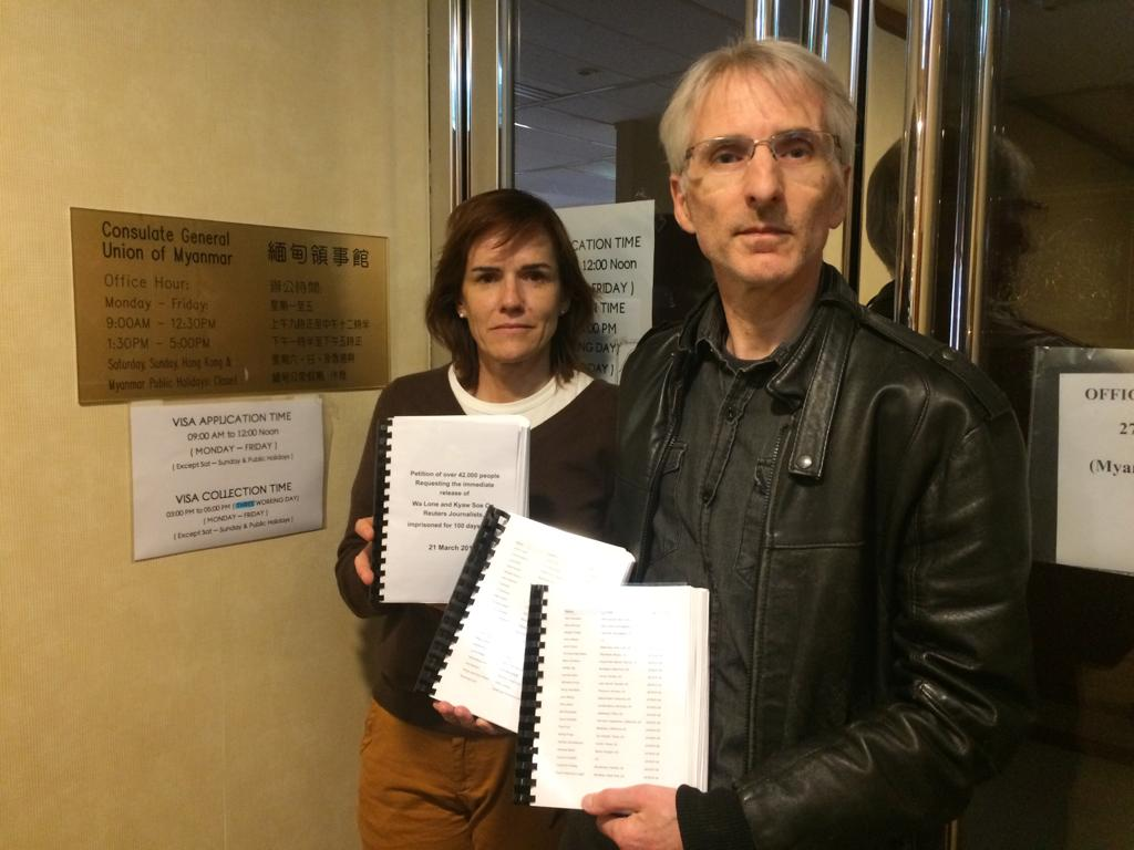 FCC Hong kong's president Florence de Changy (left) with Geoff Crothall from the Press Freedom Committee at the Myanmar consulate on March 21. The consulate had closed early but building management promised they would hand in the 3 volumes of signatures to the consulate when it opens again.