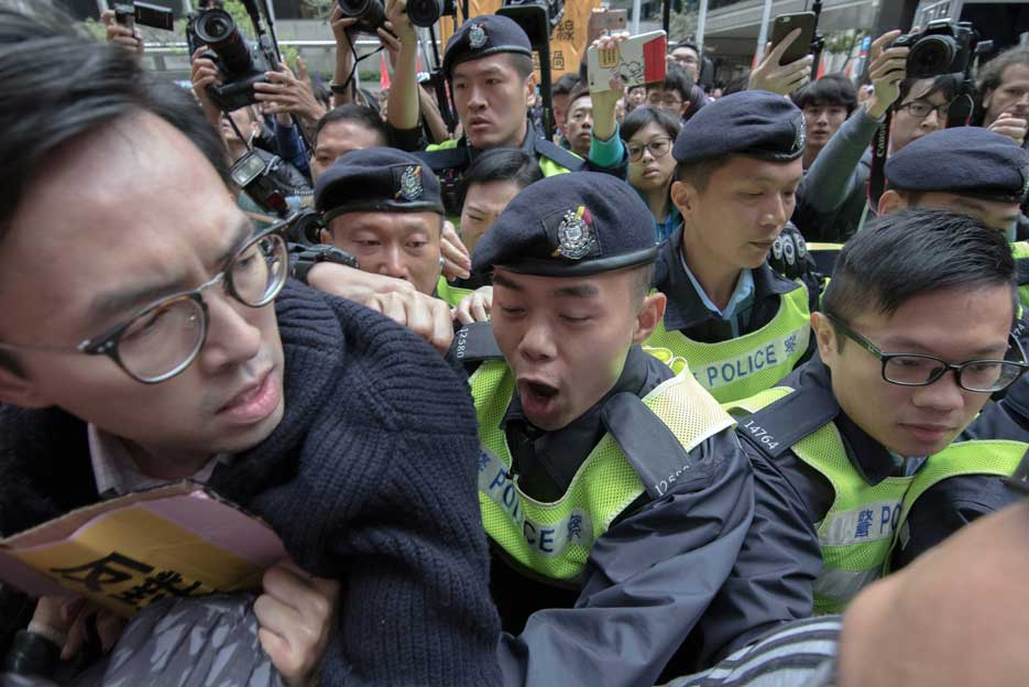 Lee Yui Chit Eugene, Hong Kong Baptist University: Avery Ng Man-yuen, chairman of the League of Social Democrats, is grabbed by police at a protest on March 26, 2017 outside the Hong Kong Convention and Exhibition Centre during the chief executive election.