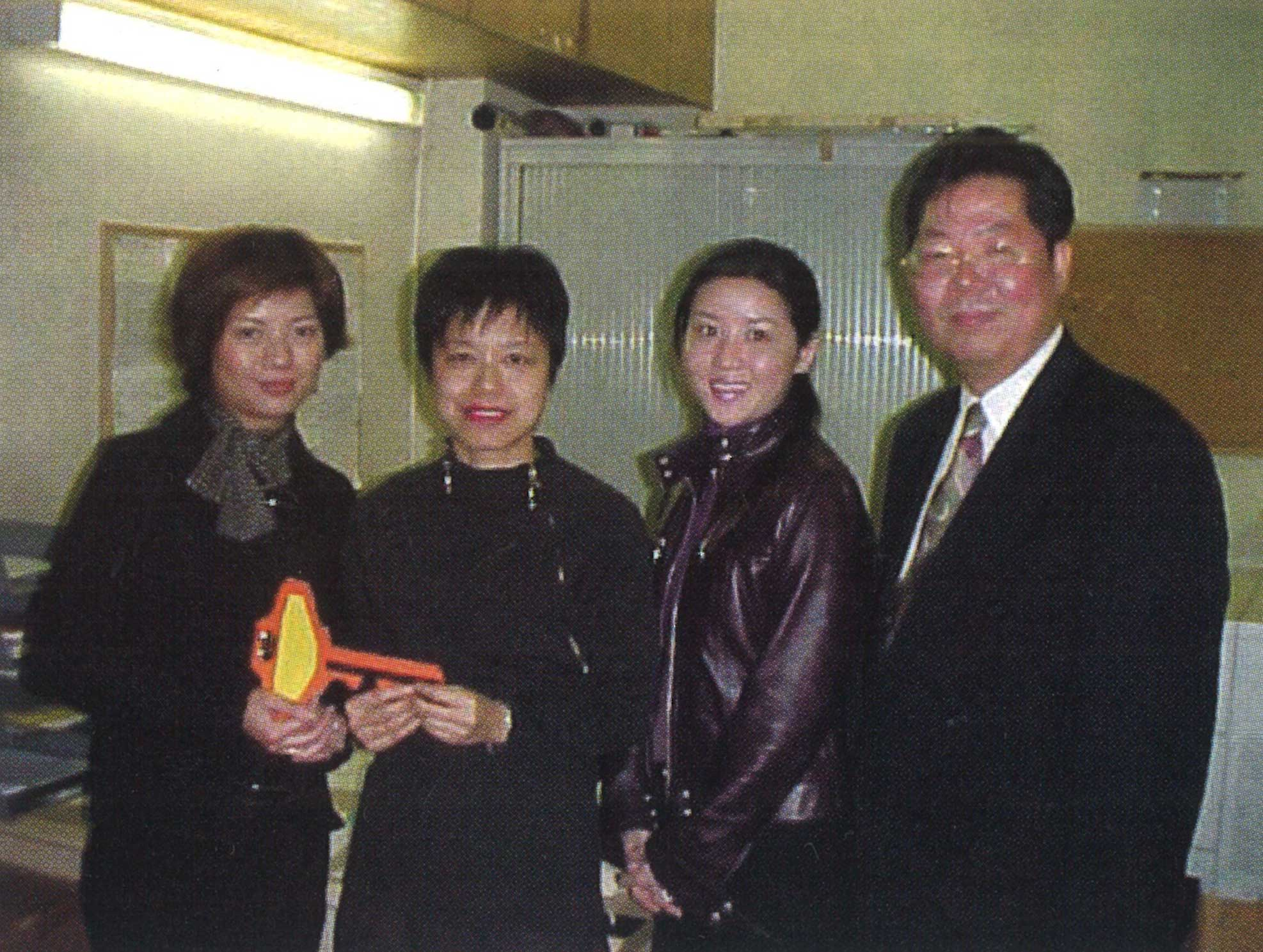 2001: Gilbert oversaw the ceremony when there was a change of Club office managers. Carol Yiu (left), the new manager, took over from Racquel Cheung. Membership secretary Canny Wong (second from right) left at the same time.
