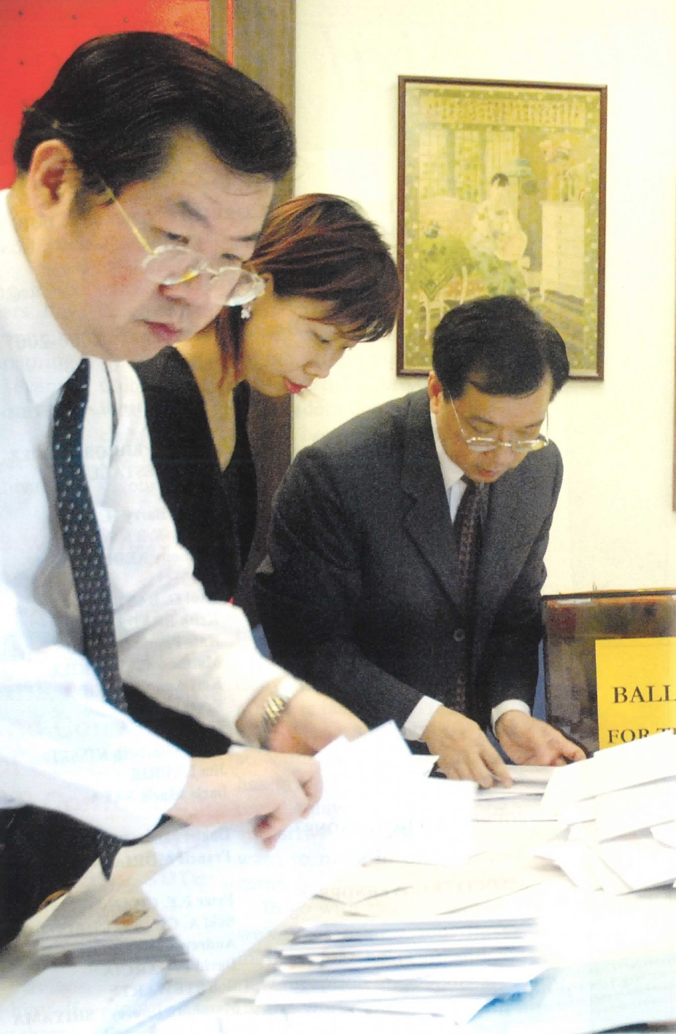 2006: Sorting the Board of Governor votes into categories. From left: Gilbert, Rosalia Ho, Michael Ho.