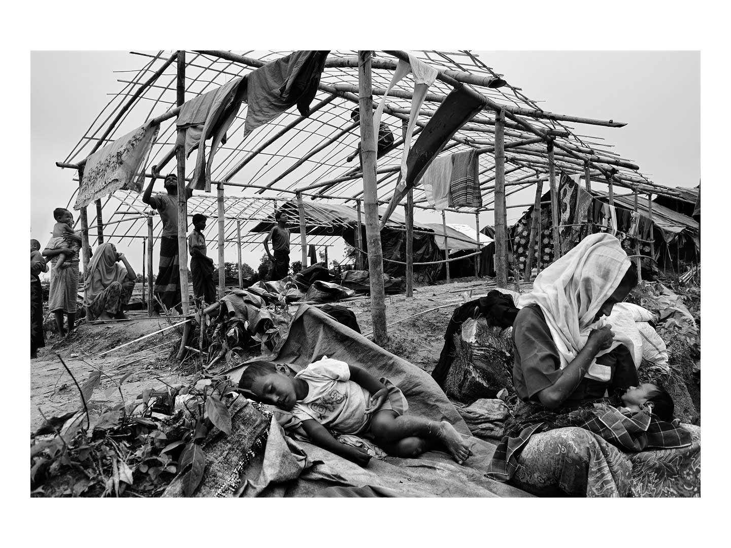 A group of Rohingya women wait for food assistance in the town of Shamlapur. Photo by Greg Constantine.
