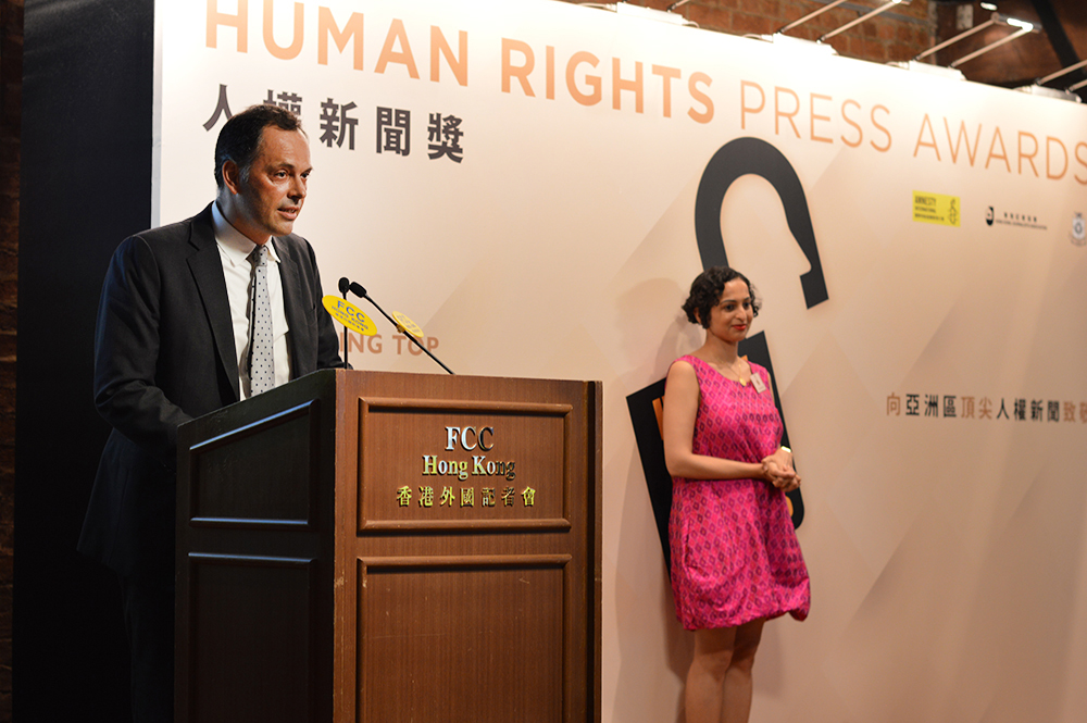 Simon Gardner of Reuters accepts the Investigative Feature Writing (English) Award on behalf of freed prisoners Wa Lone and Kyaw Soe Oo and their colleagues. Photo: FCC