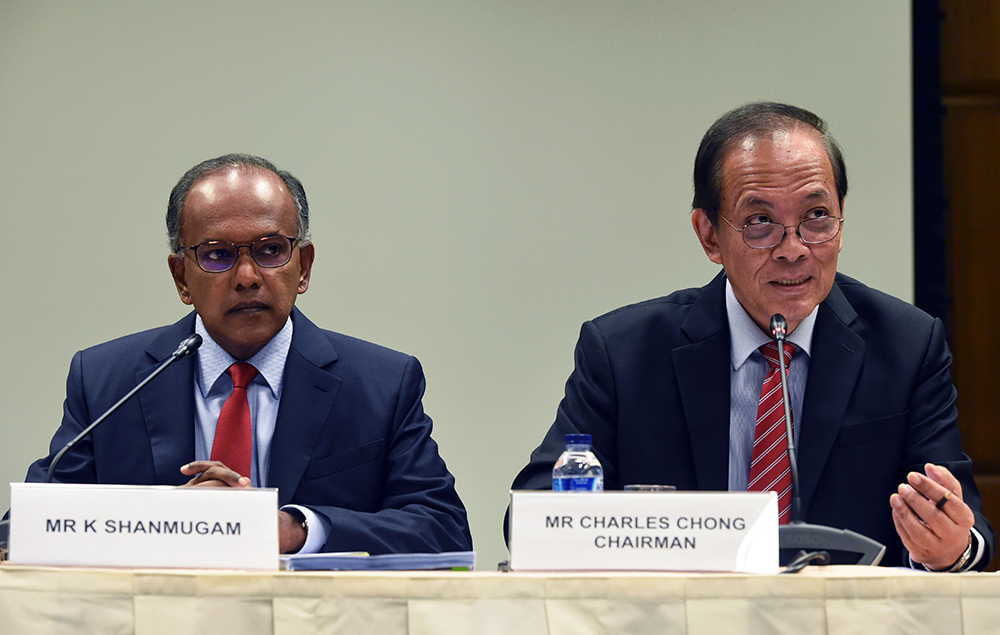 Singapore's Minister of Law K Shanmugam (2nd L) and Charles Chong, deputy speaker of the parliament and chairman of the Select Committee on Deliberate Online Falsehoods, attend a press conference in Singapore on September 20, 2018