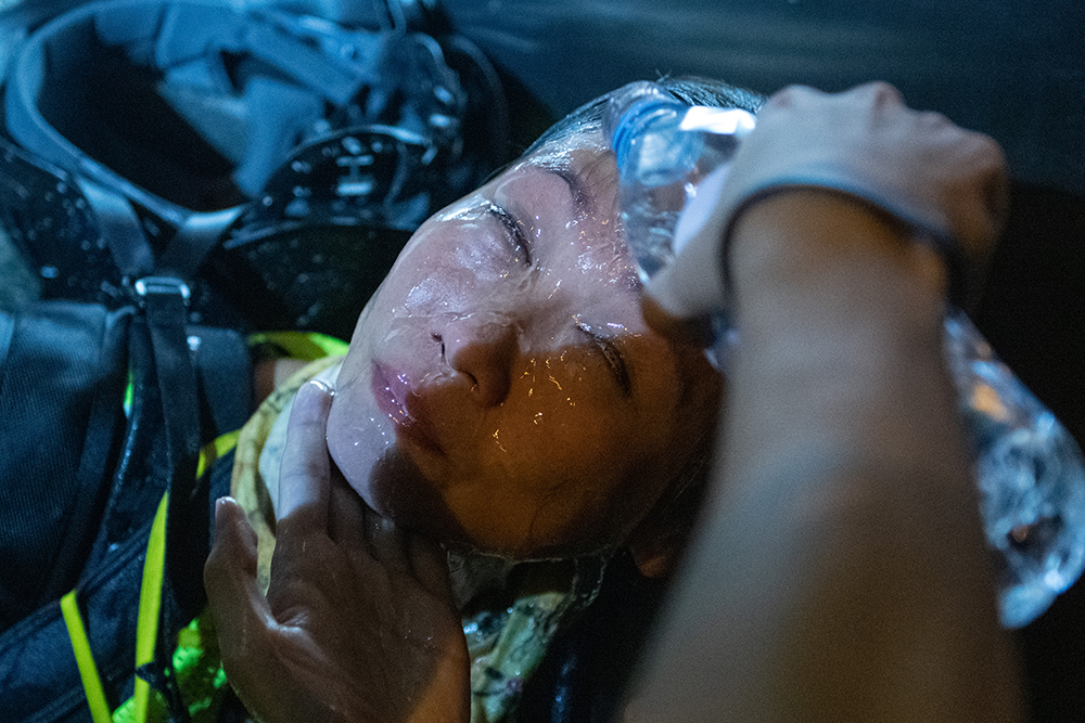 June 12: Photographer May James is treated after being pepper-sprayed