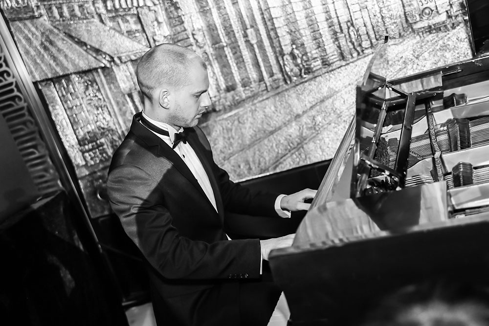 James Cowan on the hotel's restored Steinway piano