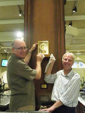 Carsten Schael and John Batten with the newly-installed clock.