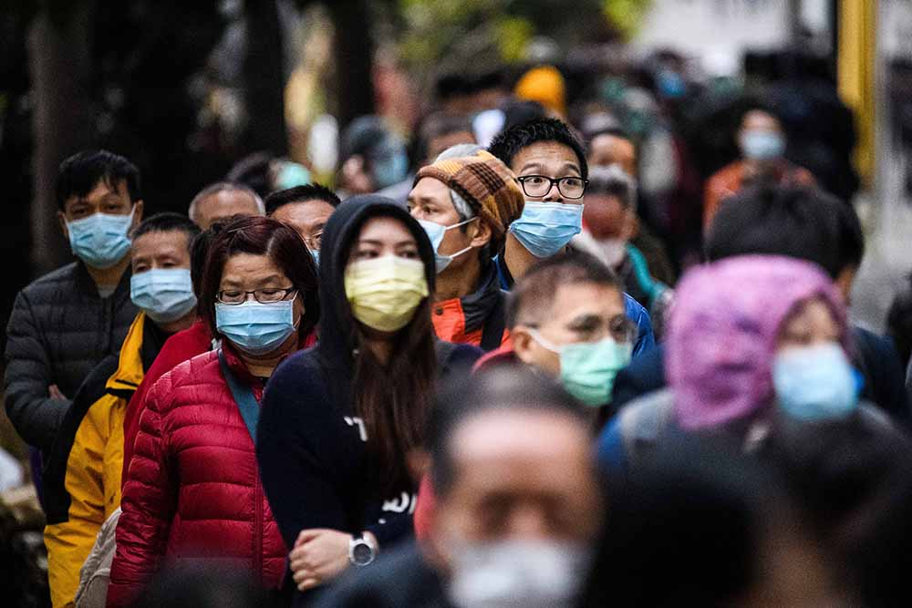 People queued up for hours to purchase face masks from a makeshift stall