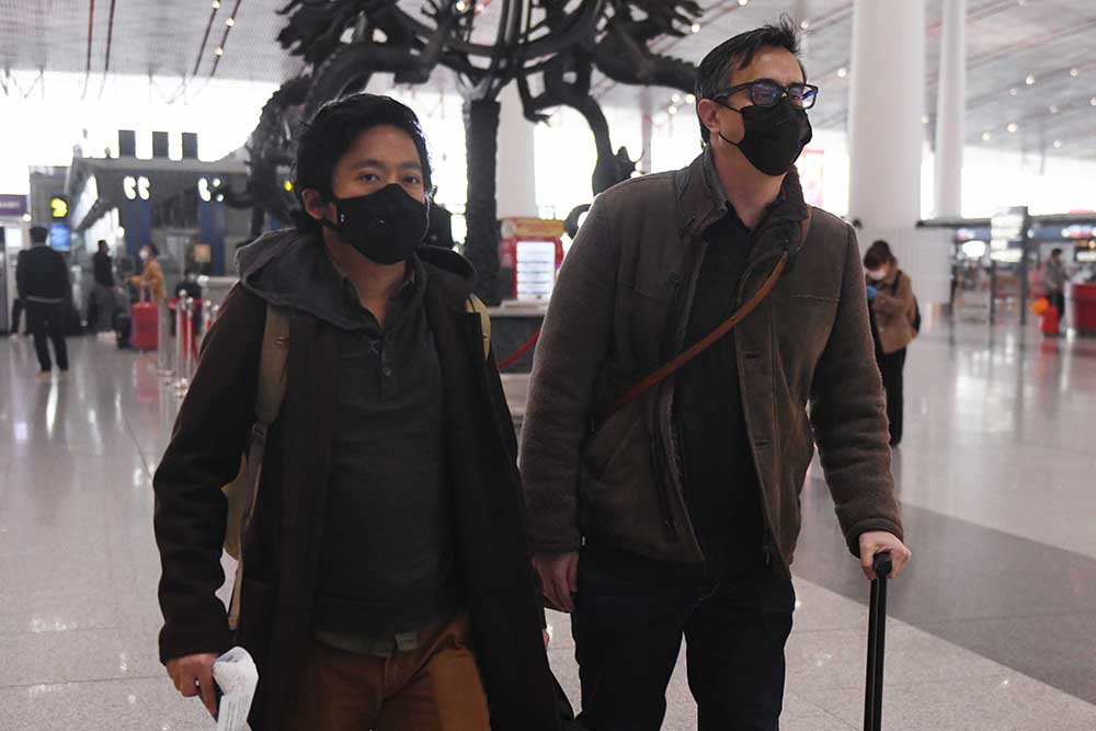Wall Street Journal reporters Philip Wen (left) and Josh Chin, expelled from China, at Beijing Capital Airport on February 24