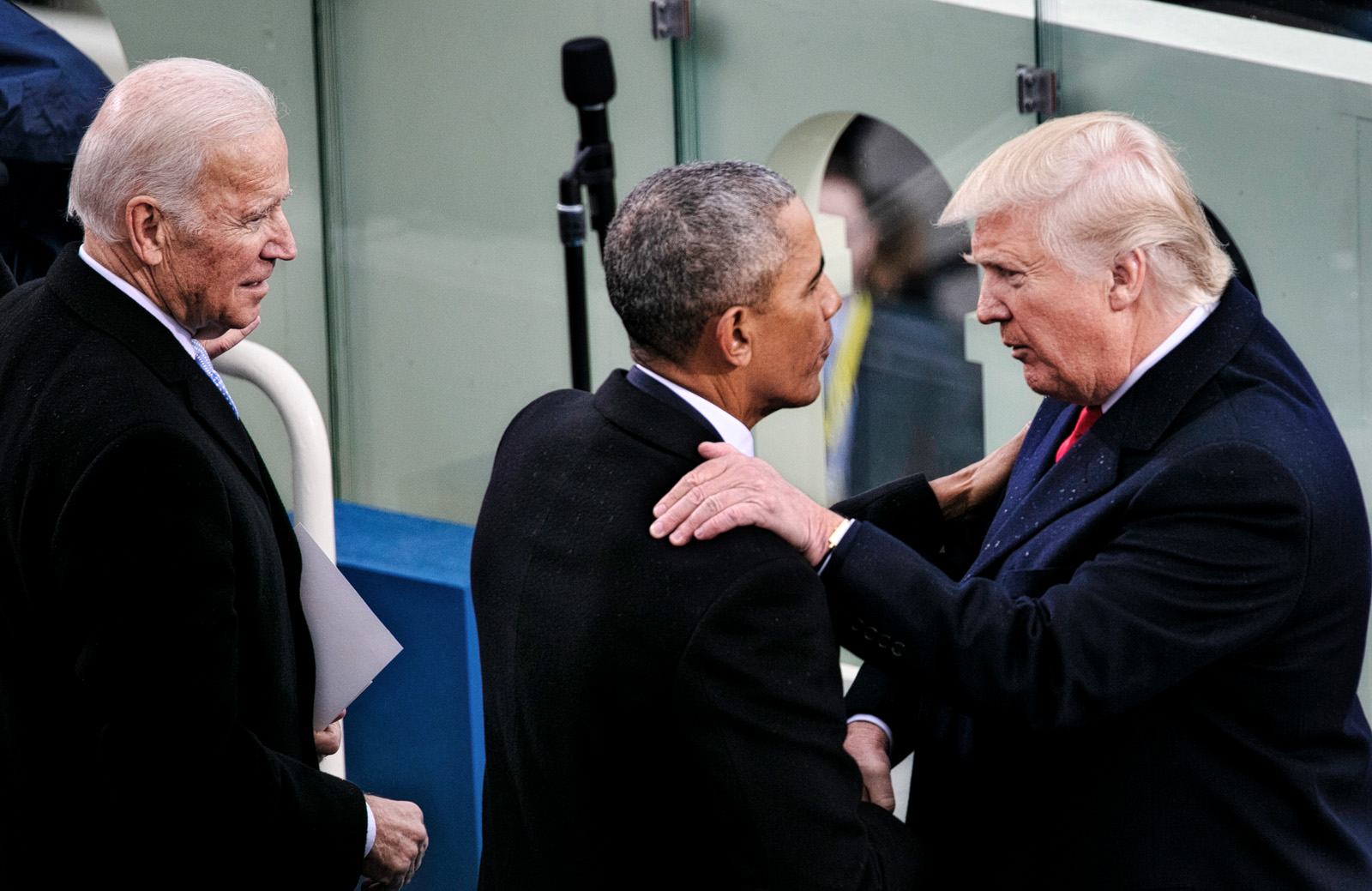 President Donald J. Trump greets former President Barack Obama immediately after being sworn in as the 45th President of the United States at the U.S. Capitol on January 20, 2017 in Washington DC. (Photo by David Hume Kennerly)