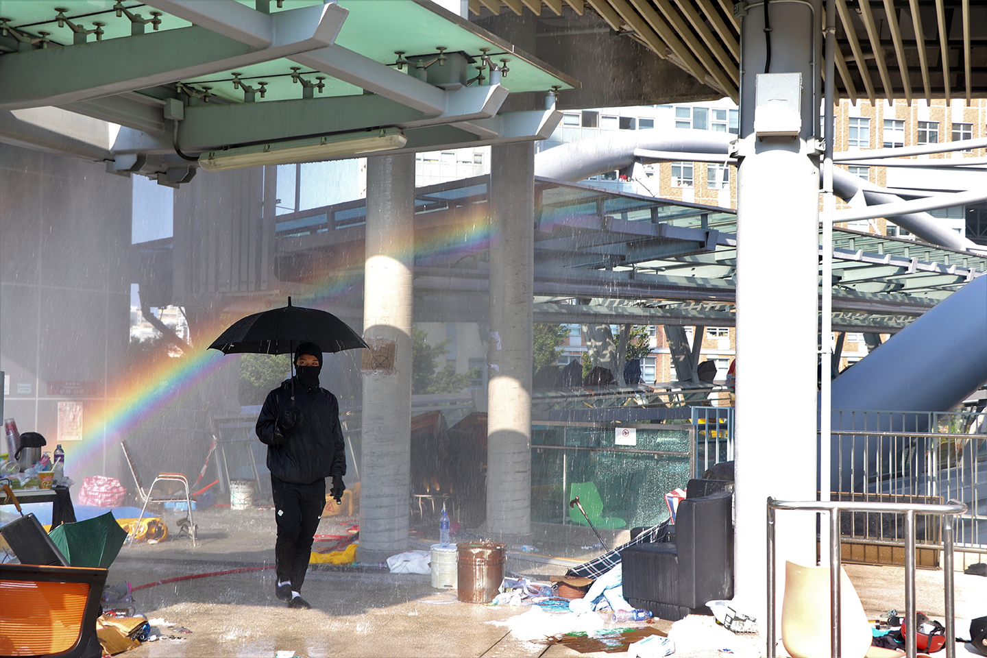 A rainbow forms near the bridge where protesters escape past riot police at the Hong Kong Polytechnic University (PolyU) campus that had been on lockdown for a week in Hong Kong, November 19, 2019