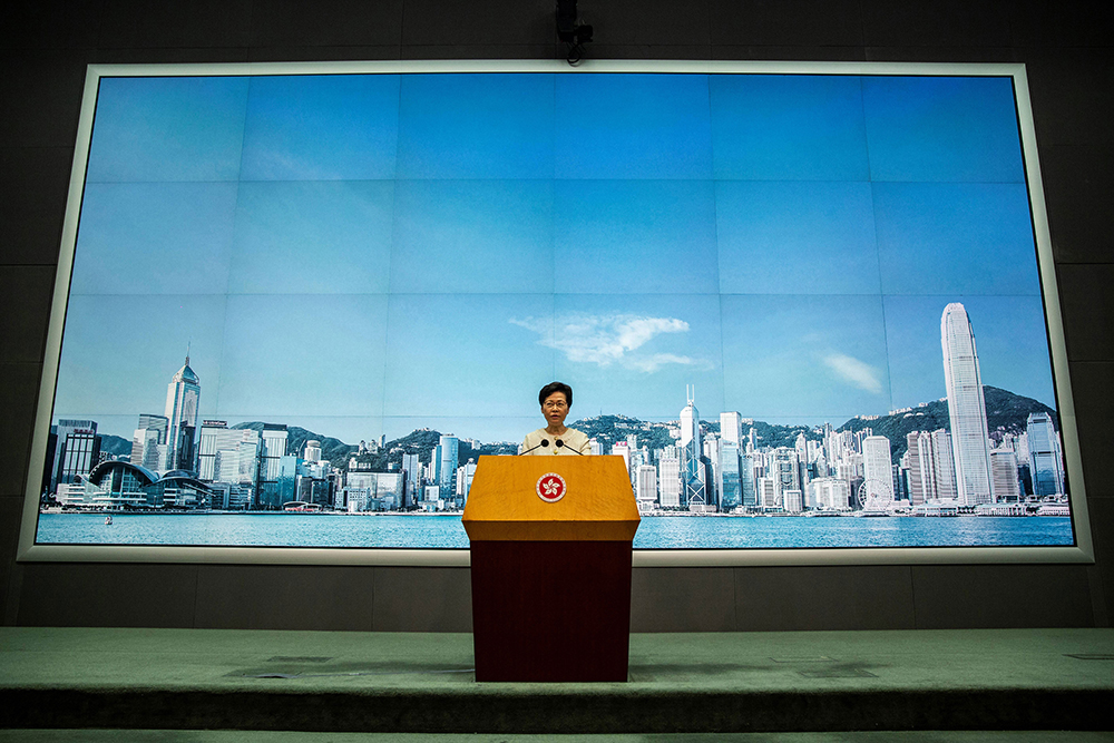 Hong Kong Chief Executive Carrie Lam discusses the national security law at a press conference on 7 July, 2020. PHOTO: ISAAC LAWRENCE / AFP