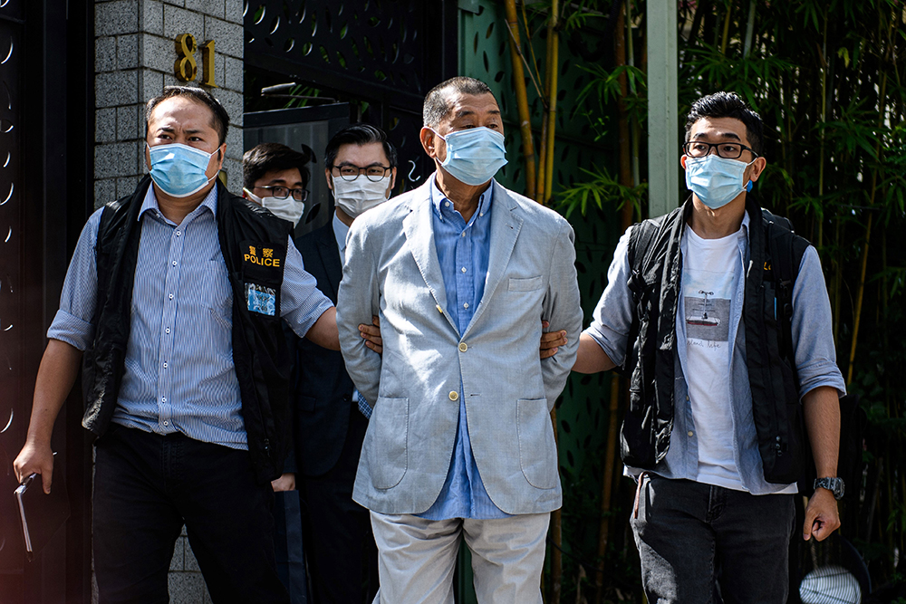 Pro-democracy media mogul Jimmy Lai (centre), 72, in police custody on 10 August, 2020. PHOTO: VERNON YUEN / AFP