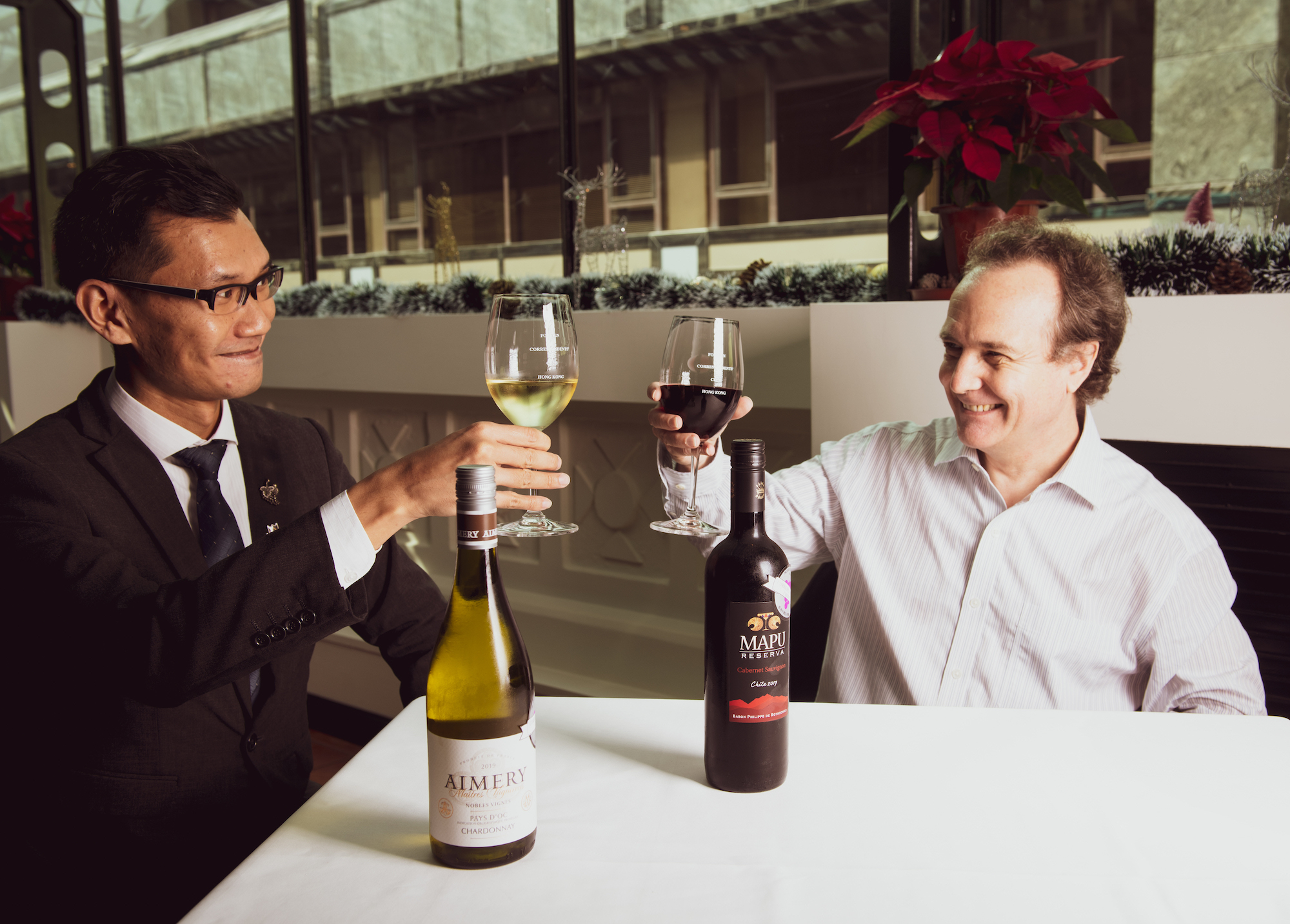 FCC Food & Beverage Manager Michael Chan (left) and Joël Leduc (right) toast to a great year of wine tasting.