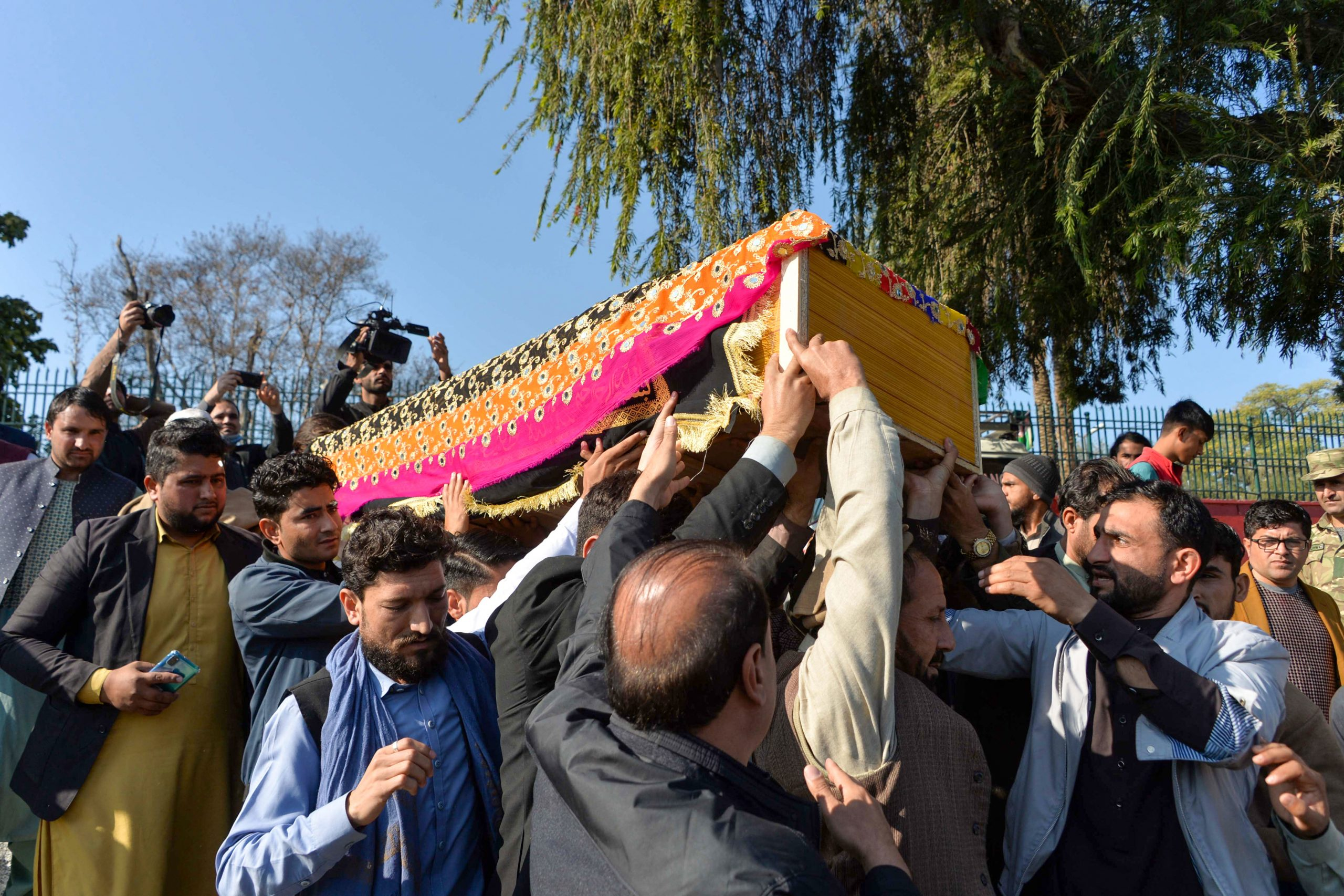 Mourners carry the coffin of female news anchor Malalai Maiwand