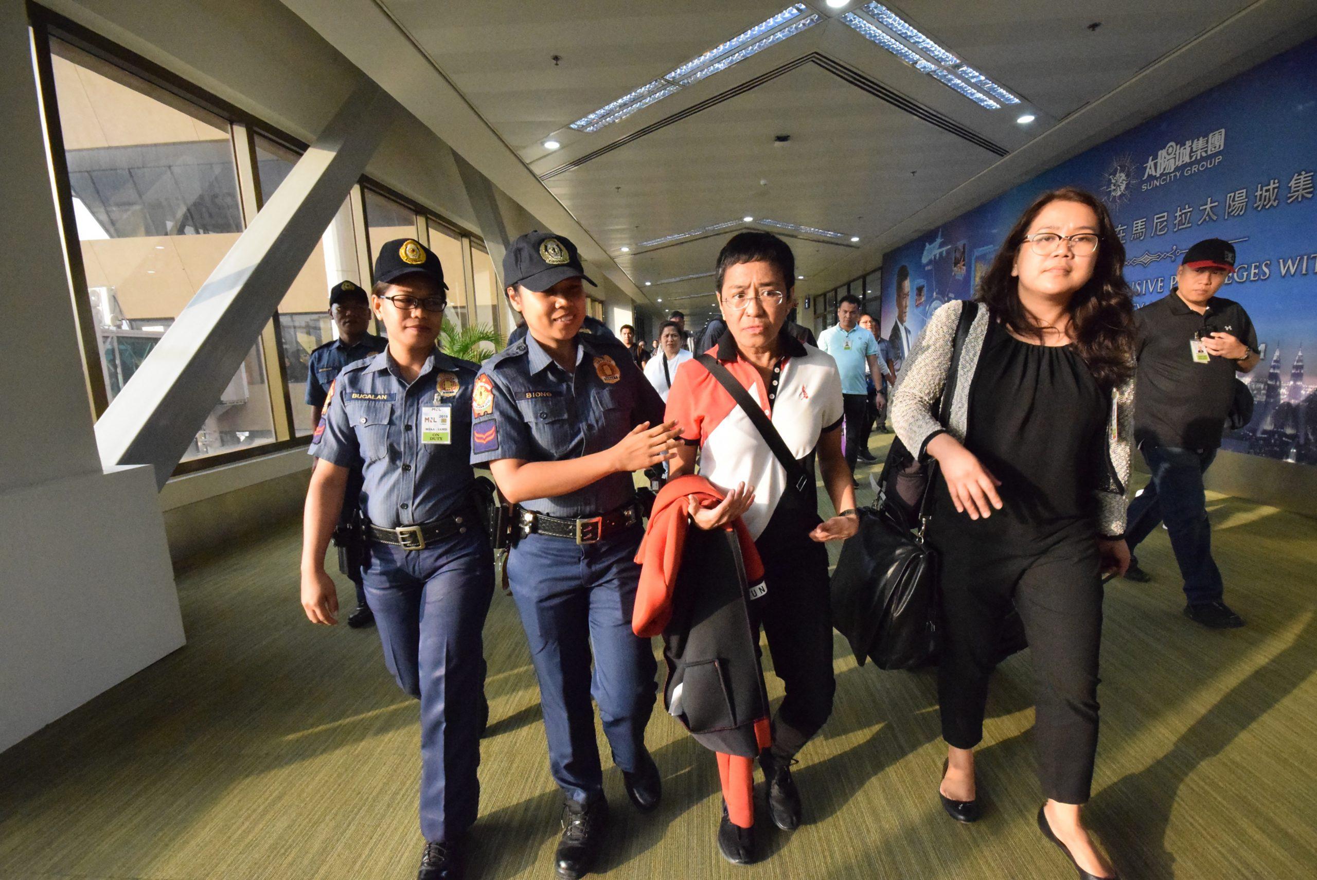 Police escort Philippine journalist Maria Ressa